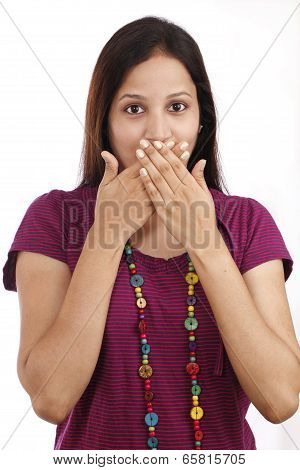 Young Woman With Hands Over Mouth