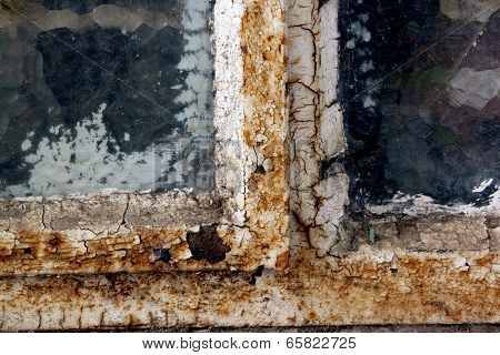 Rusty Window Frame With Cracked Glass And Flaking Putty