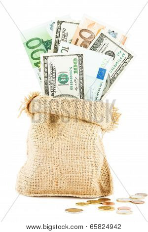Money dollars and euros in the linen bag and coins scattered near