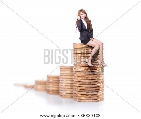 Success Business Woman Sitting On Money