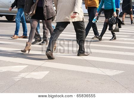 Pedestrians Cross The Street