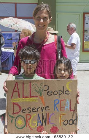 Woman And Children Hold An Anti-gmo Pro-organic Food Sign
