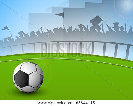 Shiny soccer ball on ground and silhouette of audience cheering-up.