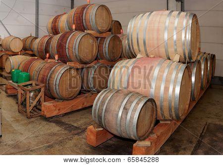 Oak casks with Pinot Noir (PN) red wine