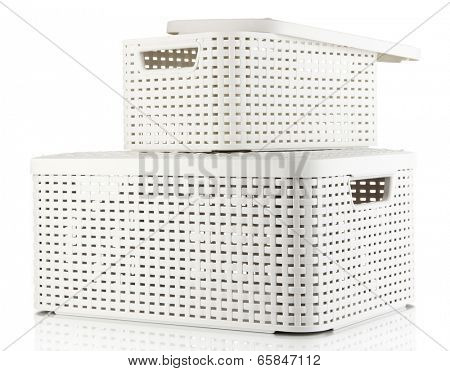 Plastic baskets for storing things isolated on white