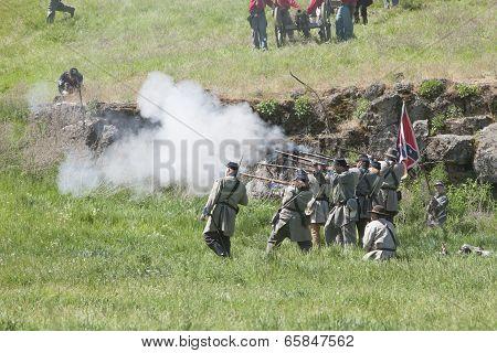 Confederate Army Reenactors In Mock Battle.