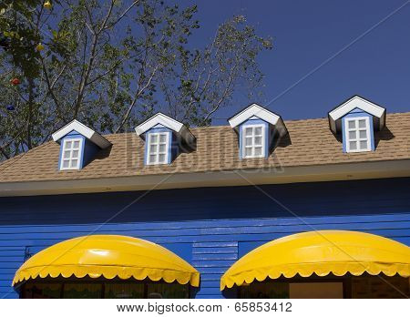Yellow Awning And Blue Windows