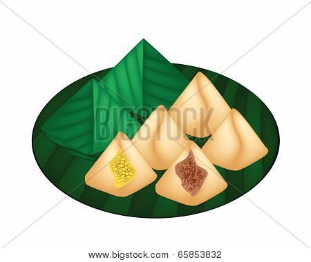 Stuffed Dough Pyramid Dessert Wrapped In Banana Leaf