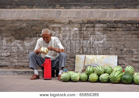 A Watermelon Street Seller Eats His Lunch, Pingyao, China