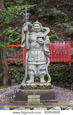 Stone Statue Of A Warrior At A Shinto Shrine In Arashiyama District, Kyoto, Japan