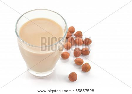 Glass Of Hazelnut Milk Or Drink On White.