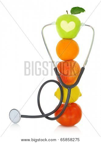 Stethoscope with fresh fruits isolated on white