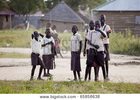 BOR, SOUTH SUDAN-NOVEMBER 12:Unidentified school children in uniform on their way home on November 12, 2013. Education is important in developing countries and is often hard to obtain.