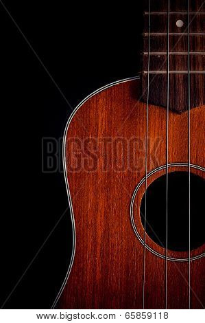 Ukulele Hawaiian Guitar Over Dark Background.