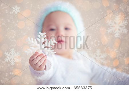 Winter Baby Showing Christmas Ornament