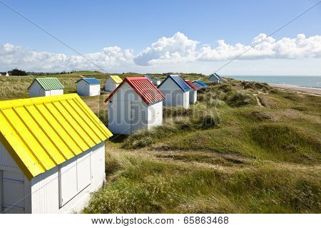 Beach cabins on the dunes of Gouville-Sur-Mer, western coast of Cotentin peninsula, Manche region, Normandy