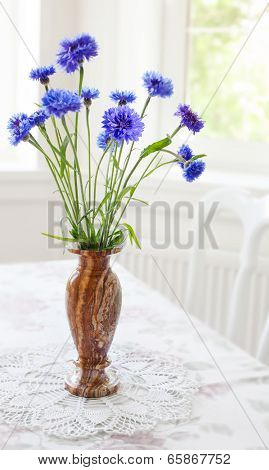 Spring bunch blue flower in vase on table