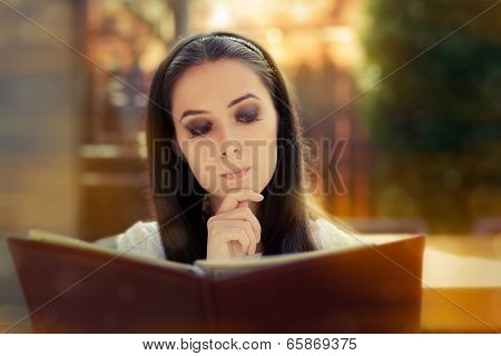 Young Woman Choosing from a Restaurant Menu