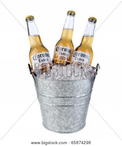 Three Bottles Of Corona Extra In A Bucket Of Ice