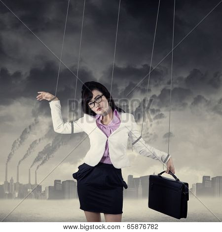 Businesswoman Controlled By Strings Outdoors