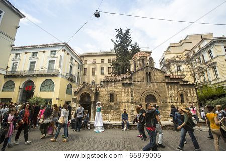 ATHENS, GREECE - MAY 10, 2014: Church of Panagia Kapnikarea in center of city. Tourism is a decisive sector of hope for Greek economy - In the year Greece receives about 18 million tourists.