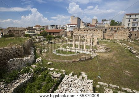 ATHENS, GREECE - MAY 10, 2014: Ruins in Athens in center of city. Tourism is a decisive sector of hope for Greek economy - In the year Greece receives about 18 million tourists.