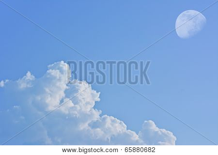 White Cloud With Moon On Blue Sky Background