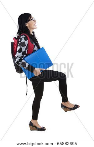 Student In Pose Stepping Upward