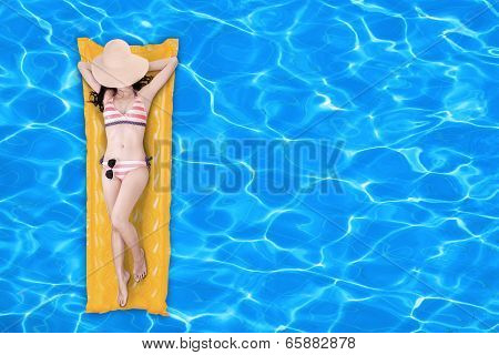 Woman Floating On A Pool Mattress