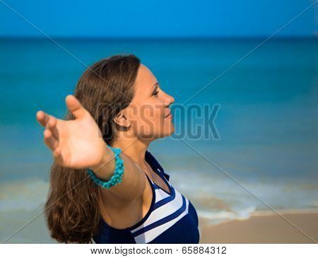 The Young Woman Standing On A Beach