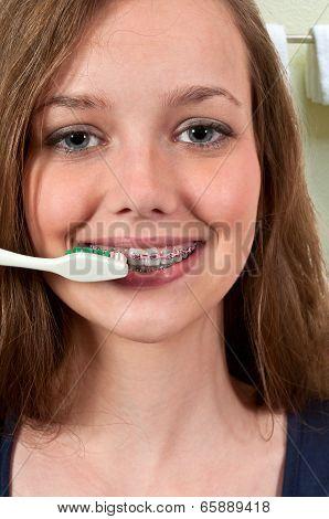 Beautiful Teenage Woman Brushing Teeth
