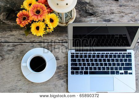 Coffee, Laptop On Wooden Table With Flower
