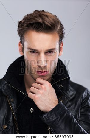 Fashion man face close up, over gray background