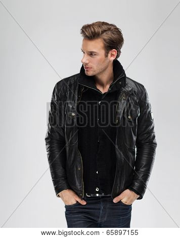 Fashion man, model leather jacket, gray background