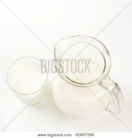 Top View Of Jug Of Milk And Glass Of Milk