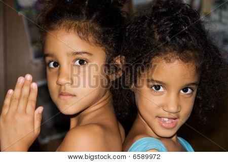 Twin sisters having fun