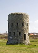 image of martello  - The British built 15 Guernsey loophole towers at various points along the coast of Guernsey between August 1778 and March 1779 to deter
