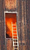 pic of fire brigade  - dangerous Orange smoke escapes from a wooden house during the fire and the scale of the fire brigade - JPG