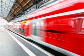 image of passenger train  - Modern red high speed electric passenger commuter train at station platform with motion blur effect - JPG