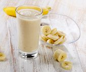 pic of banana  - Banana Smoothie on a wooden table - JPG