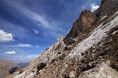 stock photo of taurus  - Rocks with snow at sun day - JPG