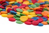 stock photo of jimmy  - Colorful candy confetti on the white background - JPG