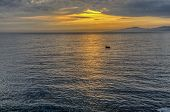 image of glow-worm  - Beautiful ocean landscape cloudy sky and worm sunset - JPG