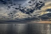 stock photo of glow-worm  - Beautiful ocean landscape cloudy sky and worm sunset - JPG