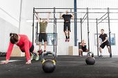 pic of squatting  - A group training push ups - JPG