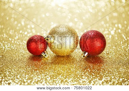 Three beautiful chritmas balls on shiny glitters