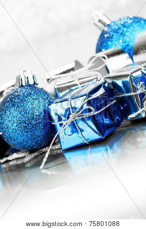 Christmas gifts and decoration on shiny glitter background