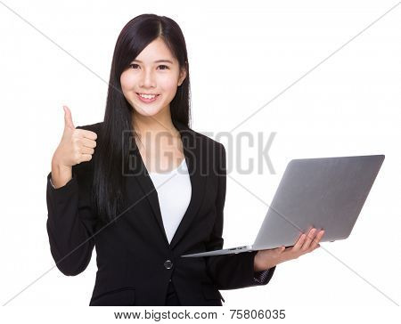 Businesswoman with laptop and thumb up