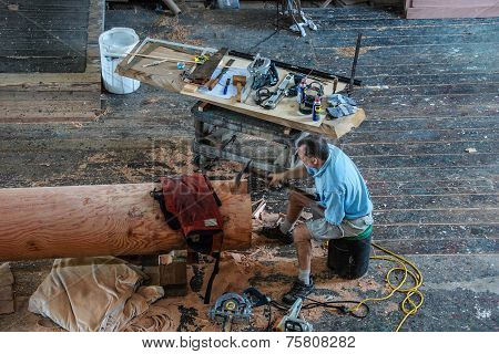 Ship's Carpenter Works On A New Mast