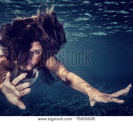 Closeup portrait of attractive woman underwater, active sportive female swimming in transparent sea, healthy lifestyle, travel and tourism concept